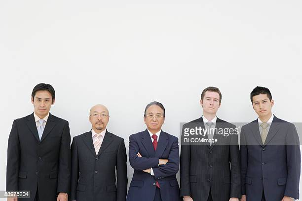 portrait of businessmen, man in middle fodling arms - 5人 ストックフォトと画像