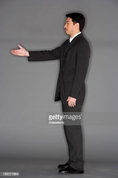Portrait of businessmen shaking hands.