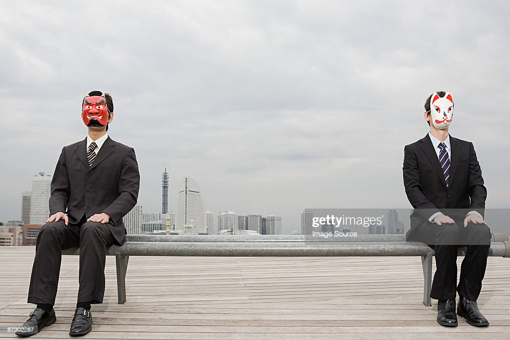 Portrait of businessmen wearing masks : Stock Photo
