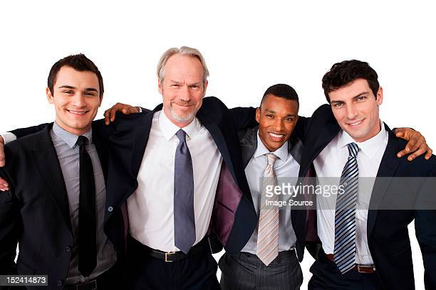 Portrait of businessmen with arms around each other