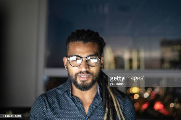 portrait of businessmen working late in the office - dreadlocks stock pictures, royalty-free photos & images