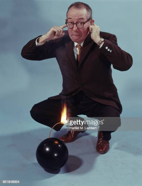 portrait of businessmnear time bomb - time bomb stock photos and pictures