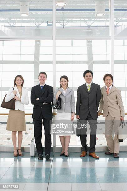Portrait of businesspeople, smiling