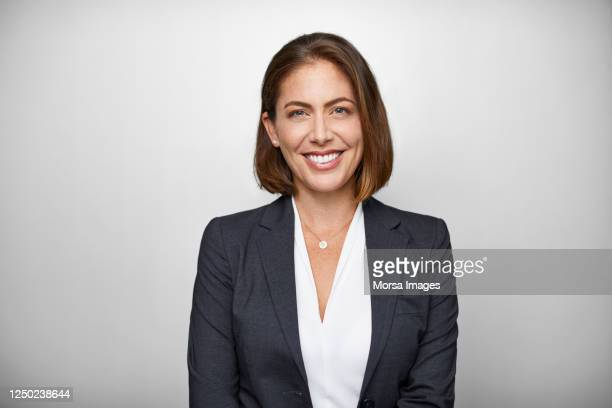 portrait of businesswoman against white background - headshot stock pictures, royalty-free photos & images