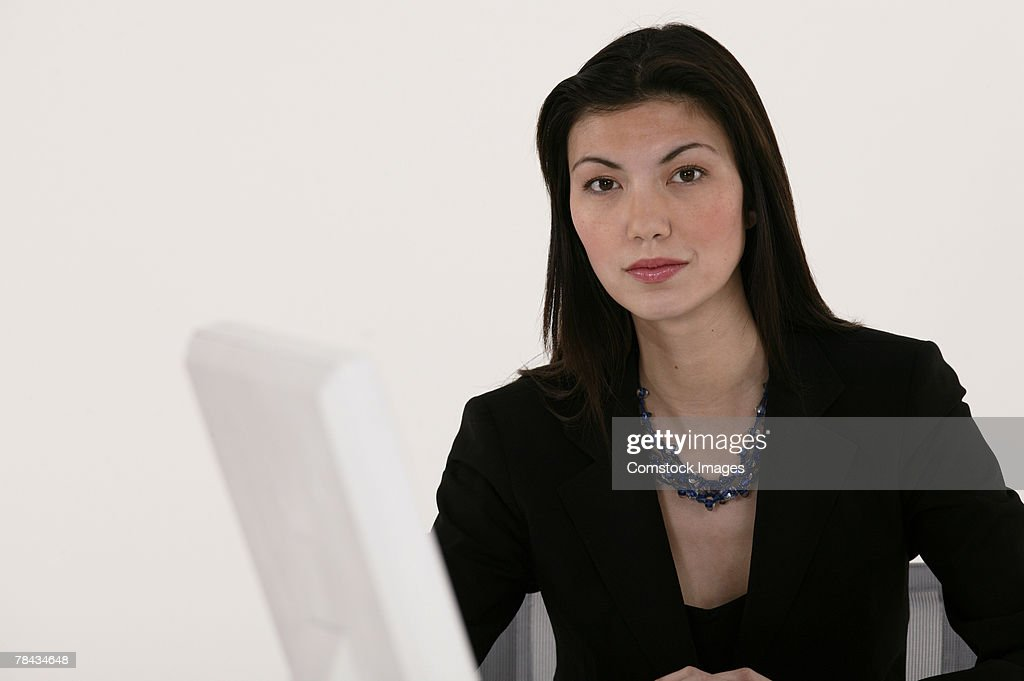 Portrait of businesswoman at computer : Stockfoto