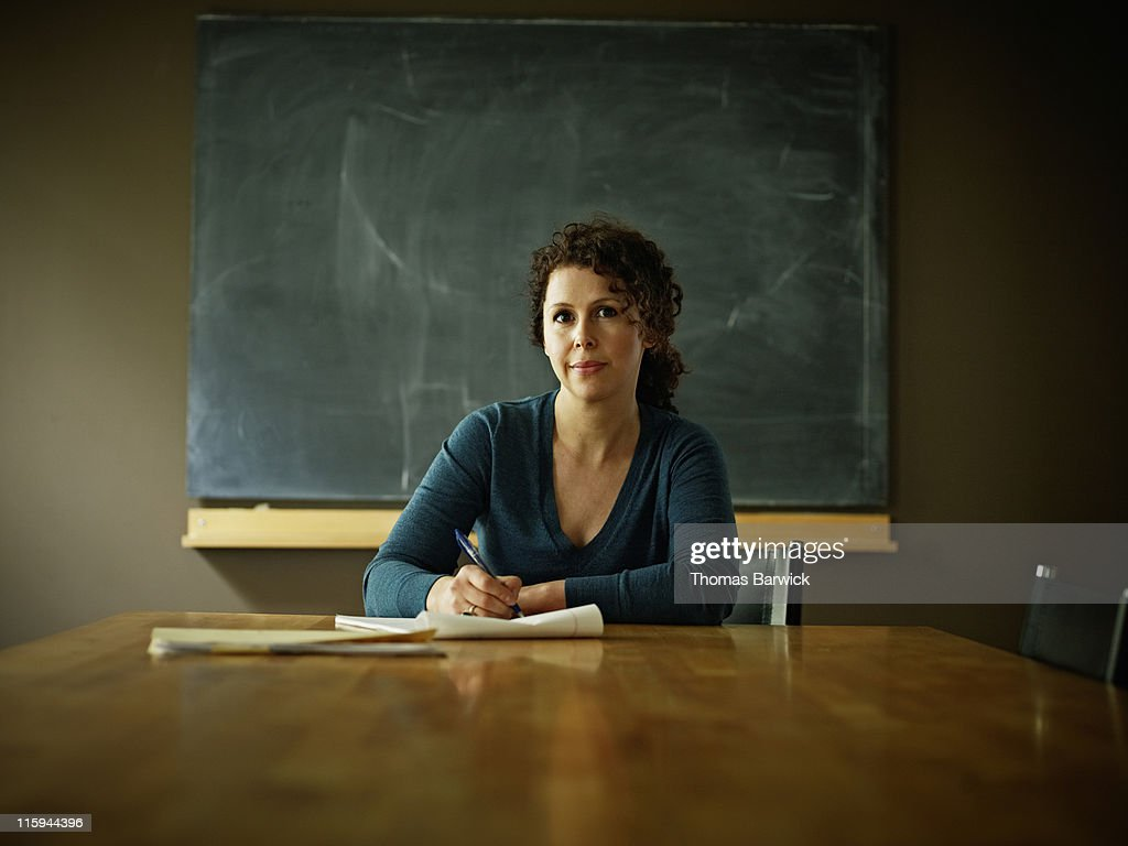 Portrait of businesswoman at conference room table : Stock Photo