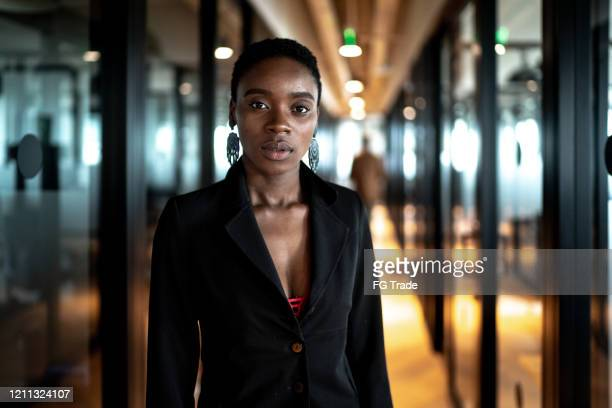 portrait of businesswoman at office corridor - shorthair stock pictures, royalty-free photos & images
