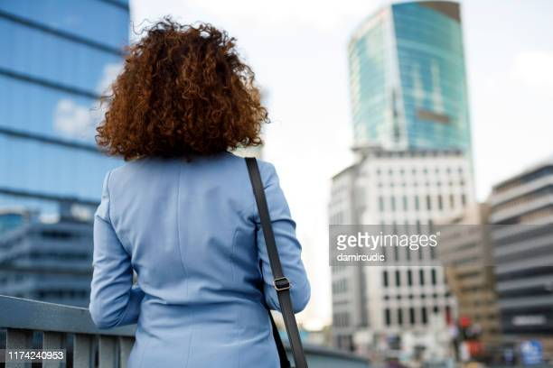 portrait of businesswoman communting to work - damircudic stock photos and pictures