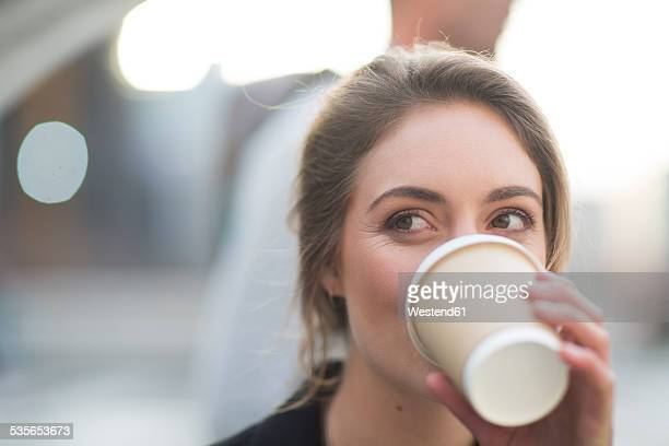 portrait of businesswoman drinking coffee to go - disposable cup stock pictures, royalty-free photos & images
