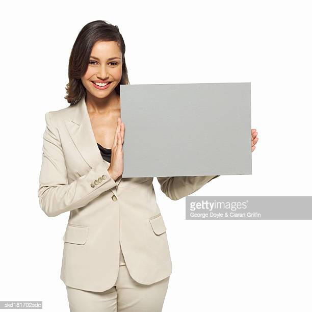 Portrait of businesswoman holding blank card