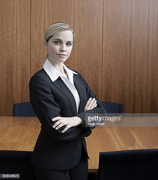 portrait of businesswoman in boardroom - hugh sitton stock pictures, royalty-free photos & images