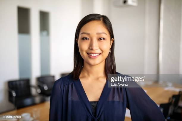 portrait of businesswoman in conference room - one young woman only stock pictures, royalty-free photos & images