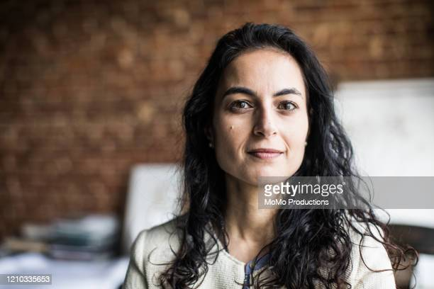 portrait of businesswoman in creative office - headshot stock pictures, royalty-free photos & images