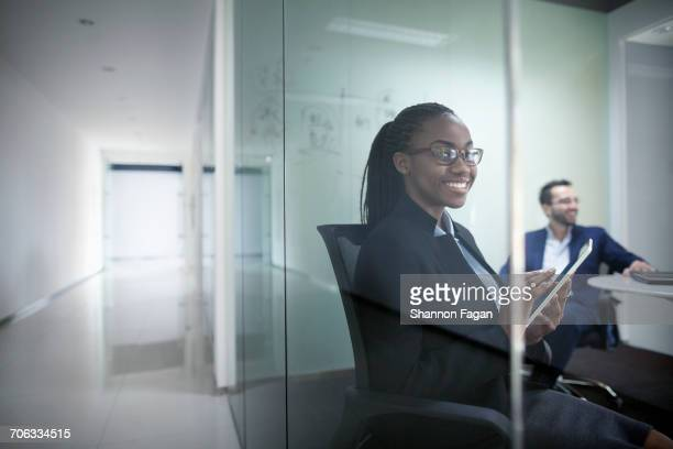 Portrait of businesswoman in glass meeting room