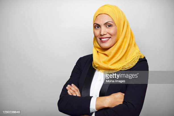 portrait of businesswoman in hijab on white background. - middle east stock pictures, royalty-free photos & images
