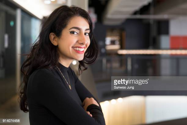 portrait of businesswoman in modern office - black hair stock pictures, royalty-free photos & images