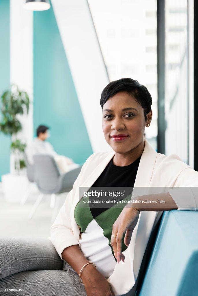 Portrait of businesswoman in modern open plan office : Stock Photo