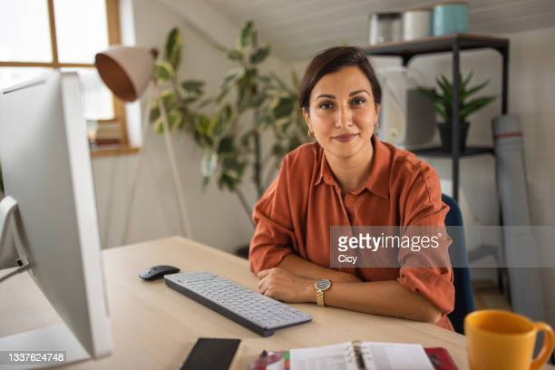 portrait of businesswoman in office - 35 39 years stock pictures, royalty-free photos & images
