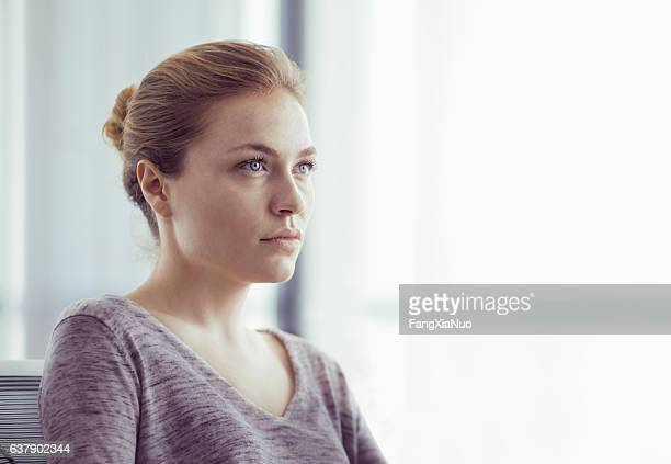 portrait of businesswoman in office - mid adult women stock pictures, royalty-free photos & images