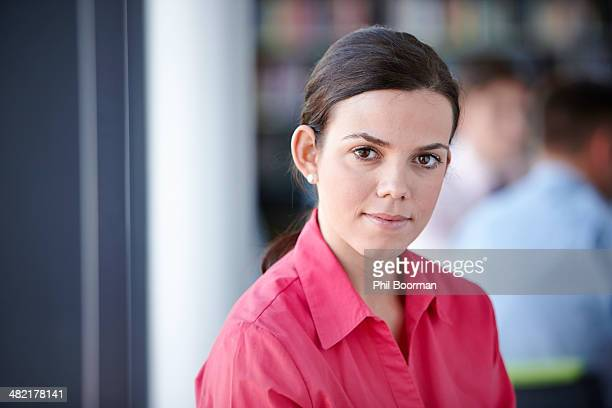 Portrait of businesswoman in red blouse