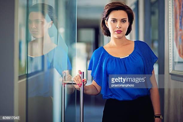 Portrait of businesswoman in the corridor