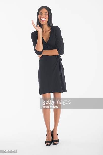 Portrait of businesswoman laughing, studio shot