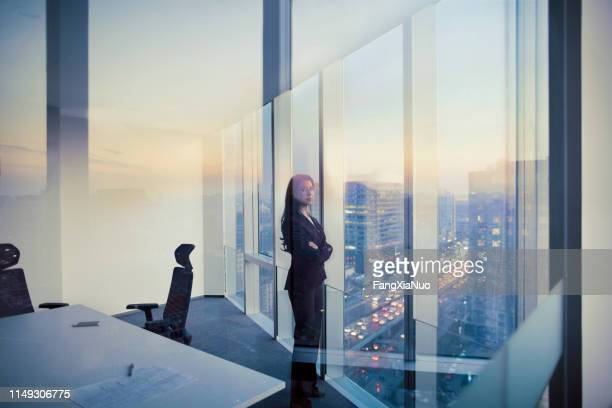portrait of businesswoman looking at camera in meeting room - change stock pictures, royalty-free photos & images