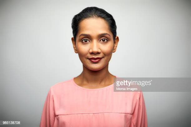portrait of businesswoman on white background - looking at camera stock pictures, royalty-free photos & images