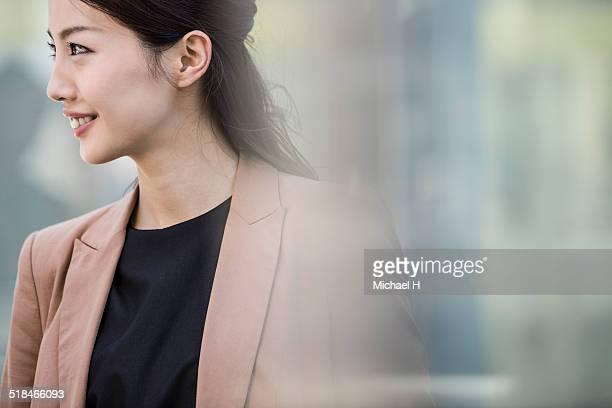 portrait of businesswoman outside - japanese ol ストックフォトと画像