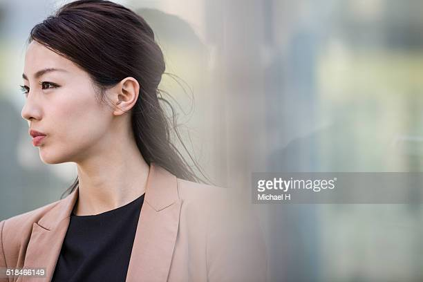 portrait of businesswoman outside - beautiful japanese women stock pictures, royalty-free photos & images
