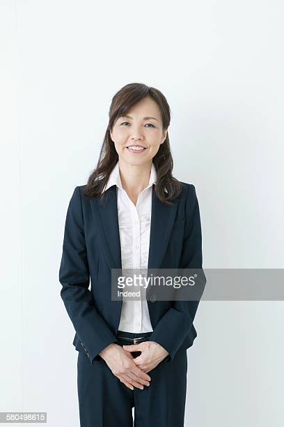 portrait of businesswoman - asian 50 to 55 years old woman stock photos and pictures