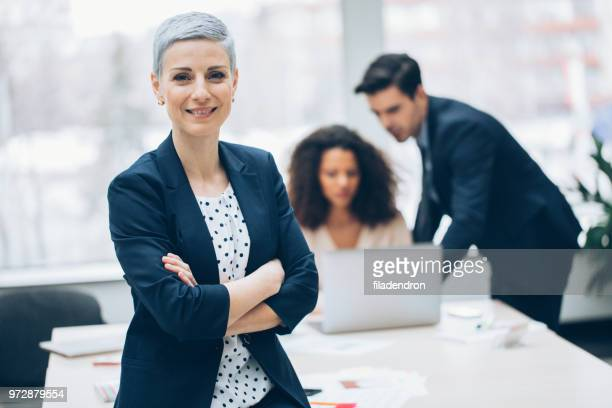 portrait of businesswoman - eastern european descent stock pictures, royalty-free photos & images