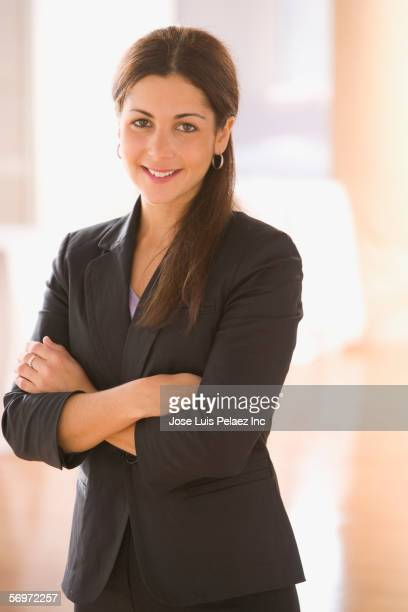 Portrait of businesswoman standing with arms crossed