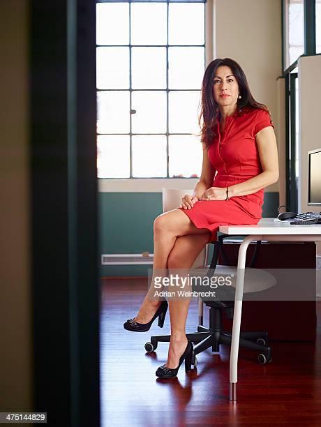 Portrait of businesswoman wearing red dress