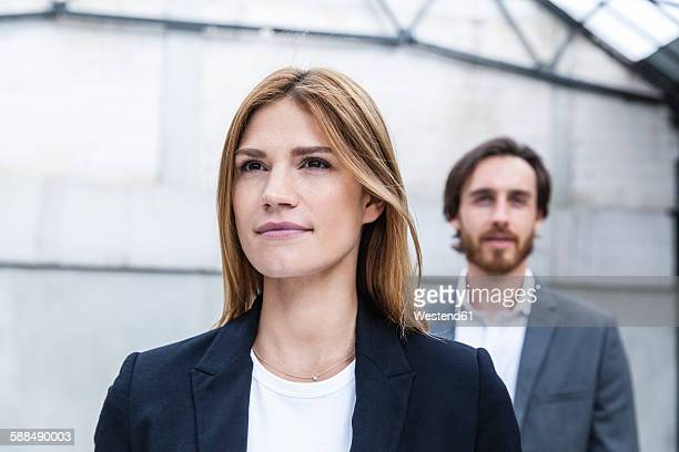 Portrait of businesswoman with her partner in the background