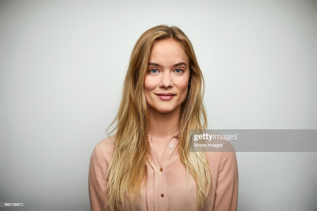 Portrait of businesswoman with long blond hair : Stock Photo