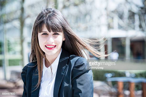 Portrait of businesswoman with long brown hair smiling