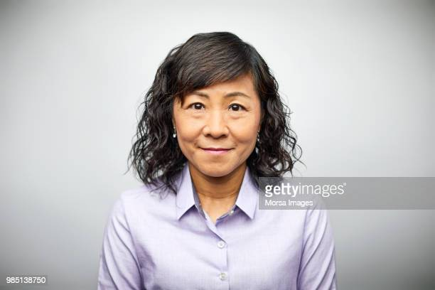 portrait of businesswoman with medium-length hair - common stock pictures, royalty-free photos & images
