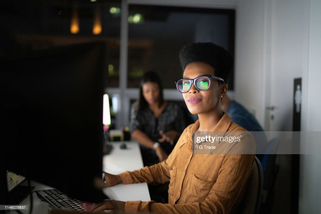 Portrait of businesswoman working late in the office : Stock Photo