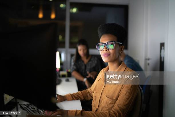 portrait of businesswoman working late in the office - confidence stock pictures, royalty-free photos & images