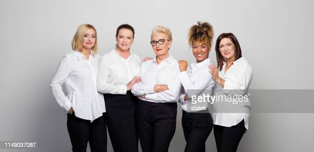 portrait of businesswomen against white background - five people stock pictures, royalty-free photos & images