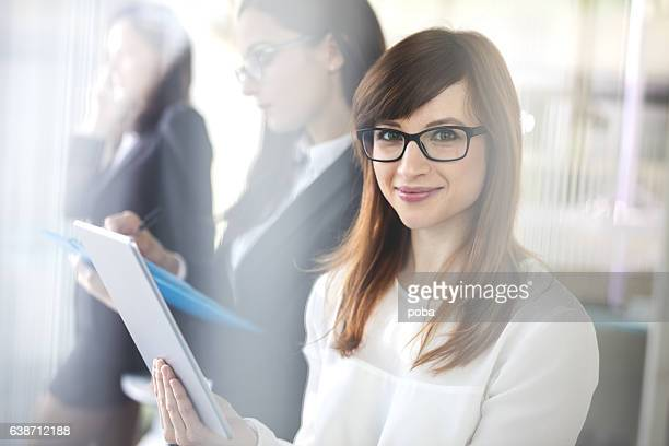 Portrait of Businesswomen using technology in  office