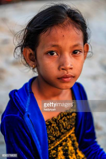 portrait of cambodian little girl on the beach, cambodia - traditionally cambodian stock pictures, royalty-free photos & images