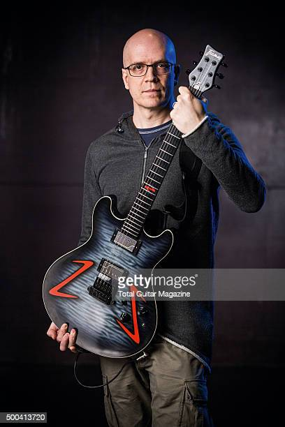 Portrait of Canadian hard rock musician Devin Townsend photographed with his Framus Mayfield Custom 297 Signature electric guitar before a live...