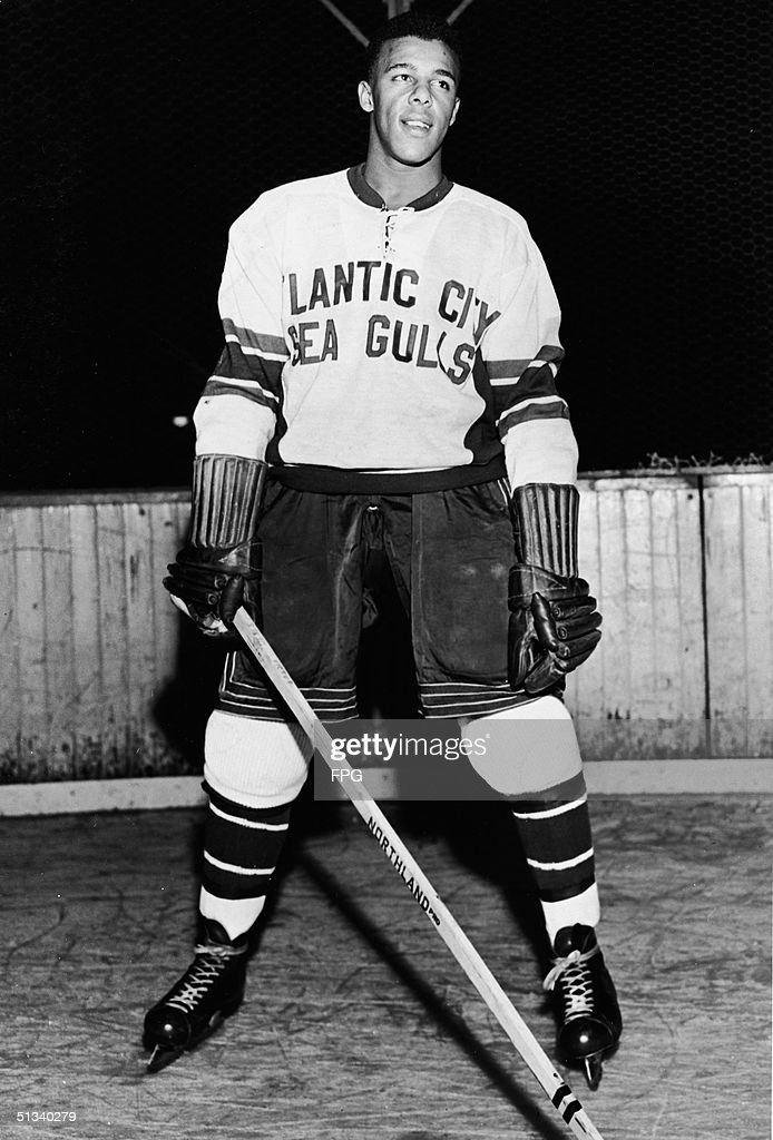 Portrait of Canadian hockey player Arthur Dorrington, dressed in the uniform of the Atlantic City Sea Gulls, Atlantic City, New Jersey, November 30, 1950. Dorrington was the first black professional hockey player in the United States.