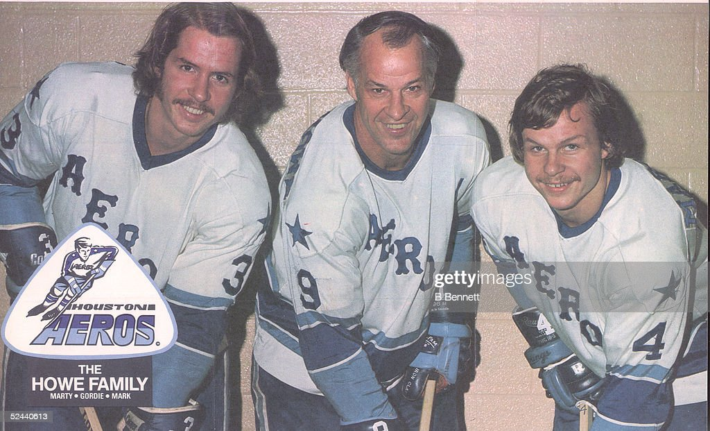 Portrait of Canadian hockey player Gordie Howe (center) and his sons Marty (left) and Mark, all of the Houston Aeros WHA hockey team, mid 1970s.