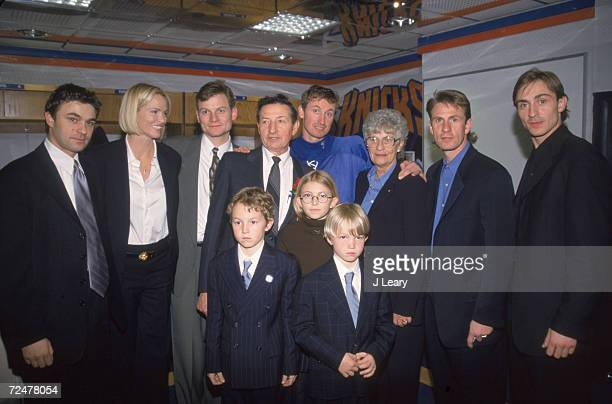 Portrait of Canadian hockey player Wayne Gretzky still in uniform and his extended family at Madison Square Garden on the occasion of Gretzky's final...