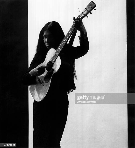 Portrait of Canadian musician Buffy SainteMarie as she plays guitar New York New York December 30 1966
