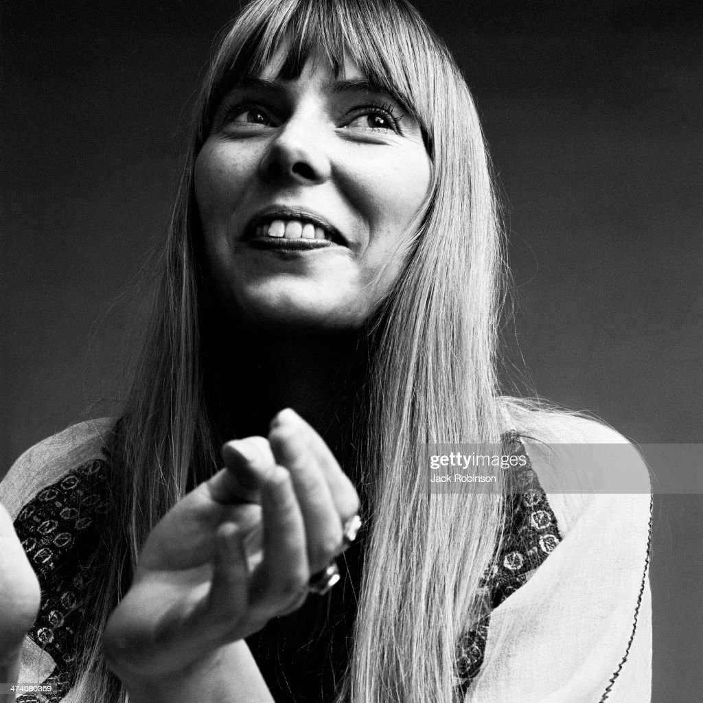 Portrait of Canadian musician Joni Mitchell wearing a loose-fitting white cotton dress, New York, November 1968. This image was from a photo shoot for the fashion magazine Vogue. Mitchell wears two rings on her hand and is in a white loose-fitting white cotton dress.