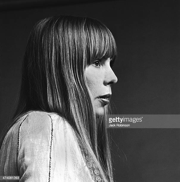 Portrait of Canadian musician Joni Mitchell wearing a loosefitting white cotton dress New York November 1968 This image was from a photo shoot for...